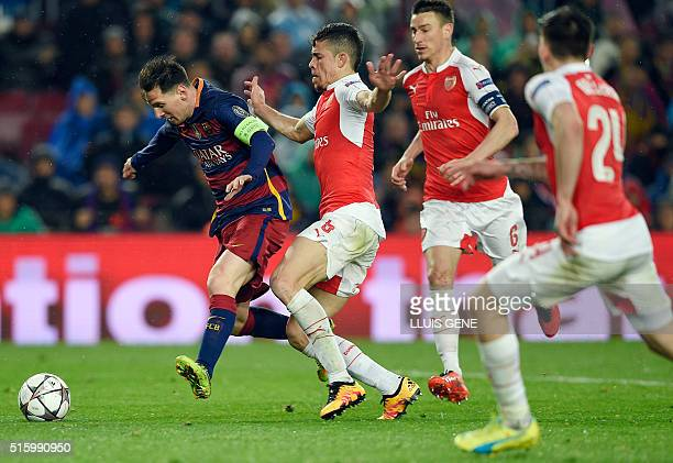 Barcelona's Argentinian forward Lionel Messi vies with Arsenal's Brazilian defender Gabriel before scoring a goal during the UEFA Champions League...