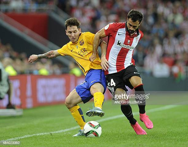 Barcelona's Argentinian forward Lionel Messi vies with Athletic Bilbao's defender Mikel Balenziaga during the Spanish Supercup firstleg football...