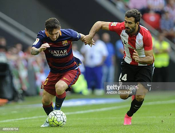 Barcelona's Argentinian forward Lionel Messi vies with Athletic Bilbao's defender Mikel Balenziaga during the Spanish league football match Athletic...