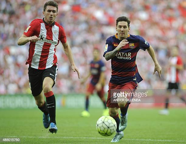 Barcelona's Argentinian forward Lionel Messi vies with Athletic Bilbao's defender Aymeric Laporte during the Spanish league football match Athletic...
