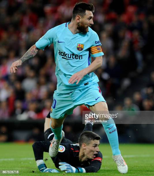 Barcelona's Argentinian forward Lionel Messi vies with Athletic Bilbao's Spanish goalkeeper Kepa Arrizabalaga Revuelta during the Spanish league...