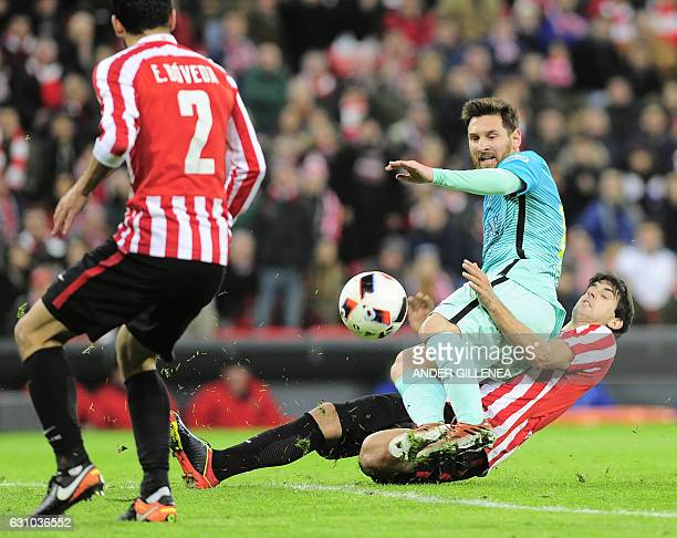 Barcelona's Argentinian forward Lionel Messi vies with Athletic Bilbao's defender Mikel San Jose during the Spanish Copa del Rey round of 16 first...
