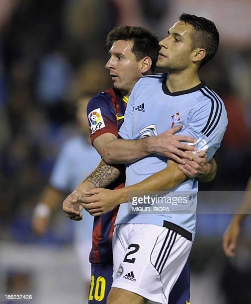 Barcelona's Argentinian forward Lionel Messi vies with Celta's defender Hugo Mallo during the Spanish league football match RC Celta de Vigo vs FC...