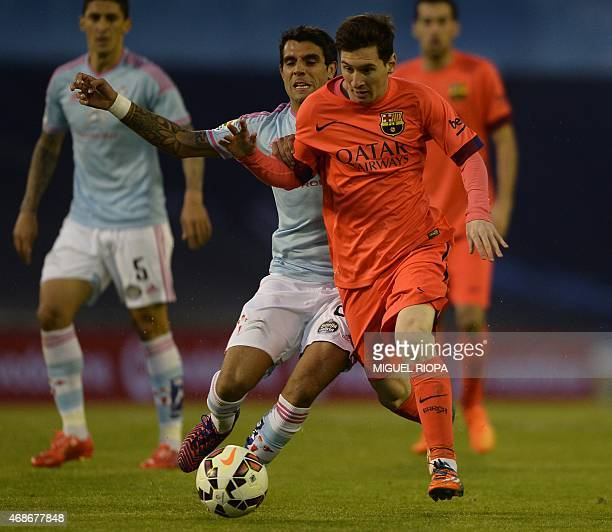 Barcelona's Argentinian forward Lionel Messi vies with Celta's Argentinian midfielder Augusto Fernandez during the Spanish league football match RC...