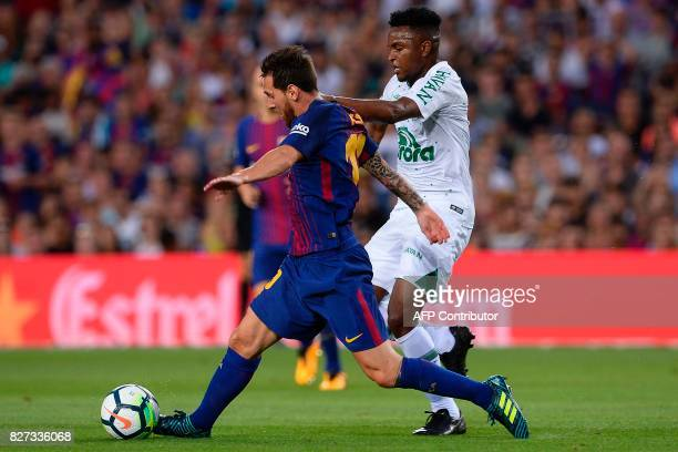 Barcelona's Argentinian forward Lionel Messi vies with Chapecoense's midfielder Moises Riveiro during the 52nd Joan Gamper Trophy friendly football...
