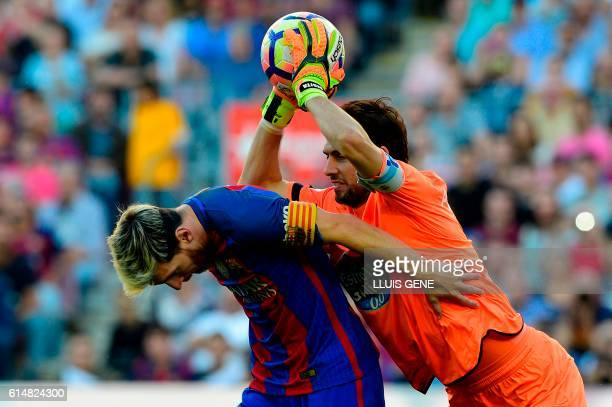 Barcelona's Argentinian forward Lionel Messi vies with Deportivo's Argentinian goalkeeper German Dario Lux during the Spanish league football match...