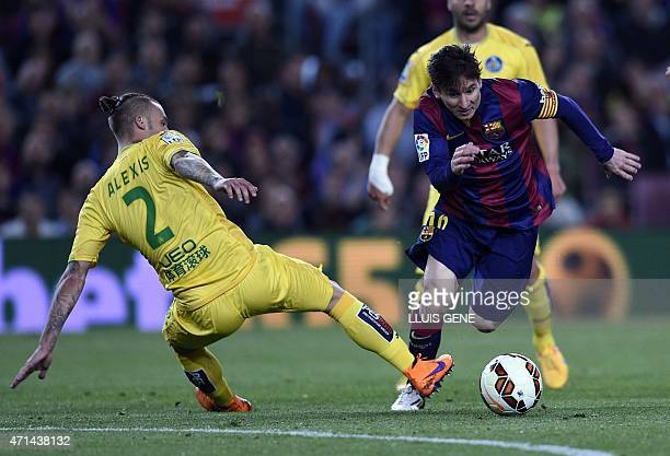 Barcelona's Argentinian forward Lionel Messi vies with Getafe's defender Alexis Ruano during the Spanish league football match FC Barcelona vs Getafe...
