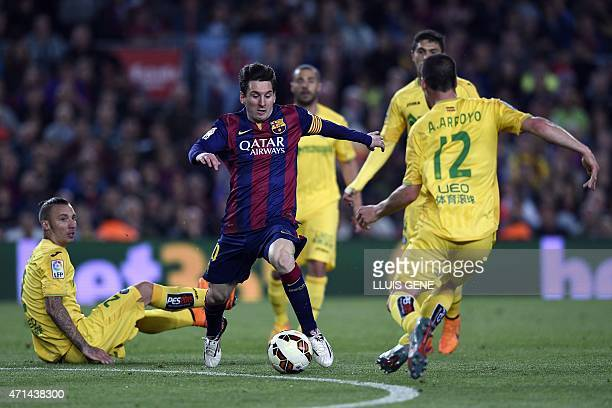 Barcelona's Argentinian forward Lionel Messi vies with Getafe's defender Alvaro Arroyo during the Spanish league football match FC Barcelona vs...