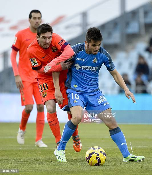 Barcelona's Argentinian forward Lionel Messi vies with Getafe's midfielder Pablo Sarabia during the Spanish league football match Getafe CF vs FC...