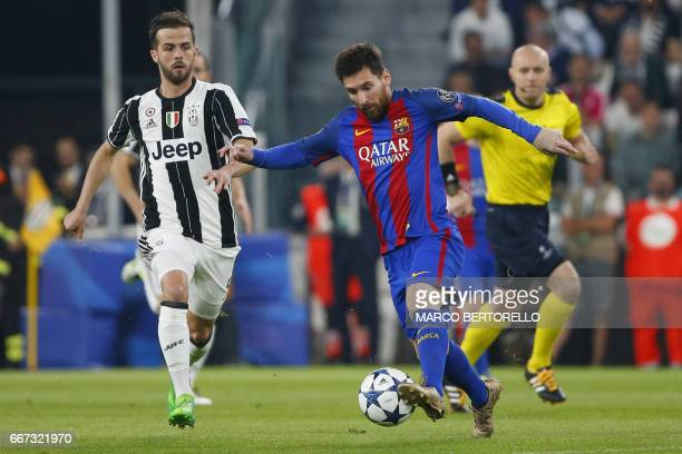 Barcelona's Argentinian forward Lionel Messi vies with Juventus midfielder Miralem Pjanic during the UEFA Champions League quarter final first leg...