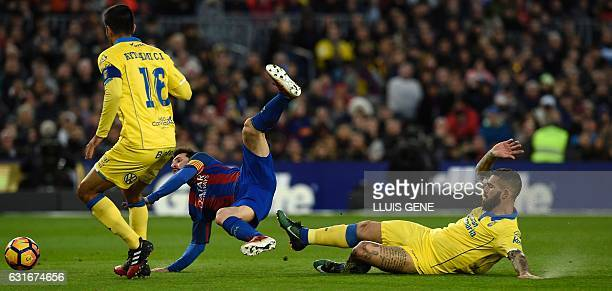 Barcelona's Argentinian forward Lionel Messi vies with Las Palmas' Croatian forward Marko Livaja during the Spanish league football match FC...