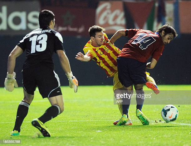 Barcelona's Argentinian forward Lionel Messi vies with Osasuna's defender Alejandro Arribas during the Spanish league football match Osasuna vs...