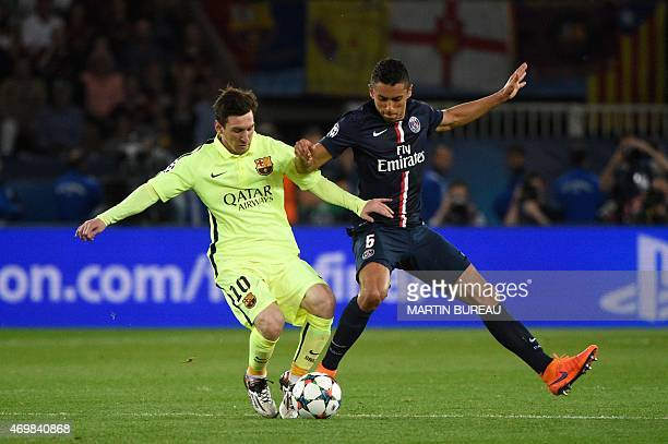 Barcelona's Argentinian forward Lionel Messi vies with Paris SaintGermain's Brazilian defender Marquinhos during the UEFA Champions league...