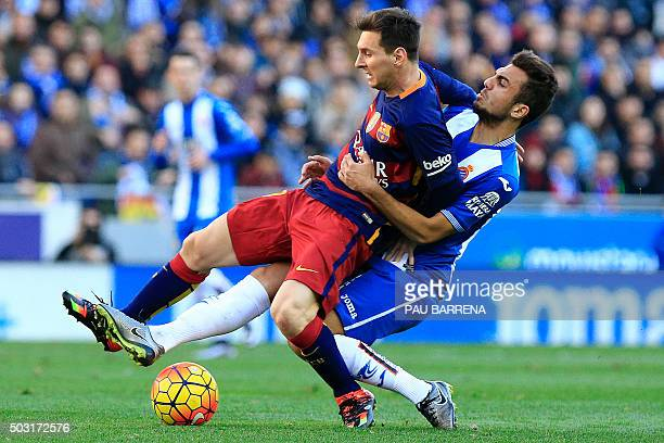 TOPSHOT Barcelona's Argentinian forward Lionel Messi vies with RCD Espanyol's Spanish midfielder Abraham Gonzalez during the Spanish league football...