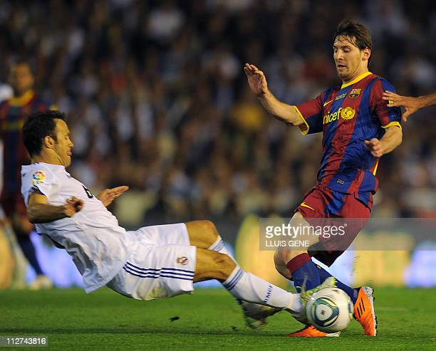 Barcelona's Argentinian forward Lionel Messi vies with Real Madrid's Portuguese defender Ricardo Alberto Carvalho during their Spanish Cup final...