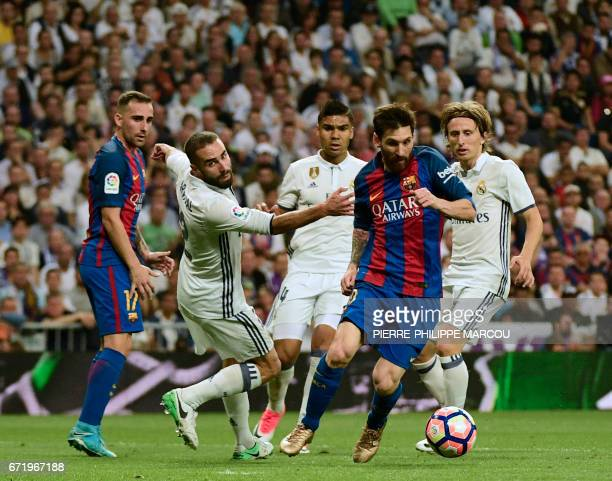Barcelona's Argentinian forward Lionel Messi vies with Real Madrid's Croatian midfielder Luka Modric Real Madrid's Brazilian midfielder Casemiro and...