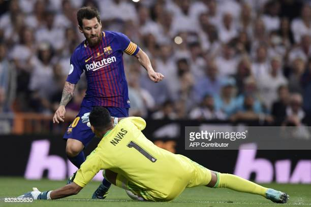 Barcelona's Argentinian forward Lionel Messi vies with Real Madrid's Costa Rican goalkeeper Keylor Navas during the second leg of the Spanish...