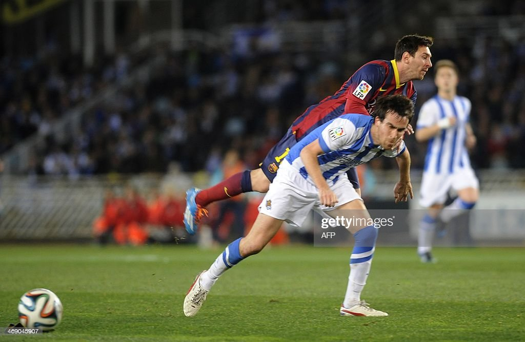Barcelona's Argentinian forward Lionel Messi vies with Real Sociedad's defender Mikel Gonzalez during the Spanish Copa del Rey football match Real...