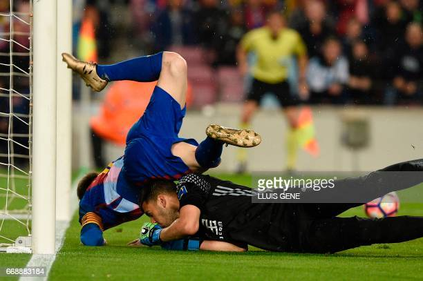 Barcelona's Argentinian forward Lionel Messi vies with Real Sociedad's Argentinian goalkeeper Geronimo Rulli during the Spanish league football match...