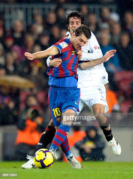 Barcelona's Argentinian forward Lionel Messi vies with Sevilla's French defender Julien Escude during their Spanish League football match on January...