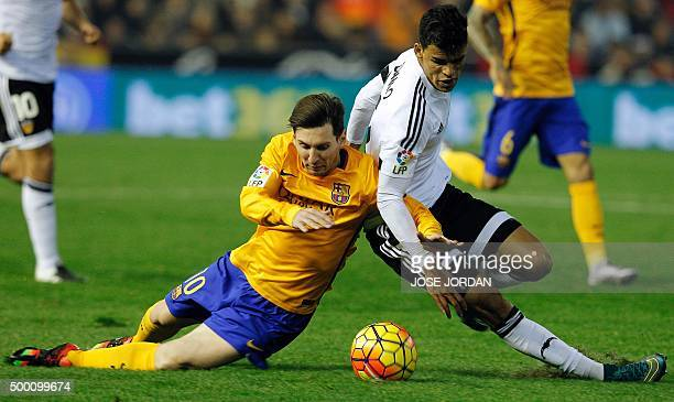 Barcelona's Argentinian forward Lionel Messi vies with Valencia's Salvadorean midfielder Danilo Barbosa during the Spanish league football match...