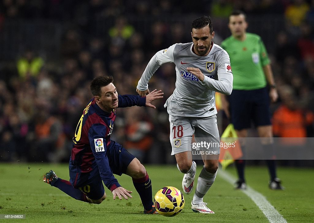 Barcelona's Argentinian forward <a gi-track='captionPersonalityLinkClicked' href=/galleries/search?phrase=Lionel+Messi&family=editorial&specificpeople=453305 ng-click='$event.stopPropagation()'>Lionel Messi</a> (L) vies wth Atletico Madrid's defender Jesus Gamez (R) during the Spanish league football match FC Barcelona vs Club Atletico de Madrid at the Camp Nou stadium in Barcelona on January 11, 2015. AFP PHOTO/ LLUIS GENE