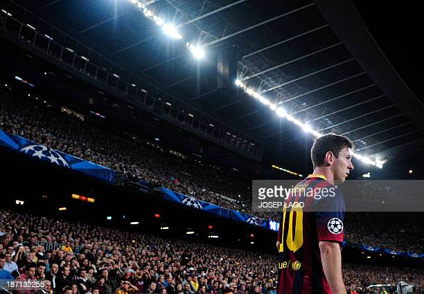 Barcelona's Argentinian forward Lionel Messi waits to shoot a corner during the UEFA Champions league football match FC Barcelona vs AC Milan at the...