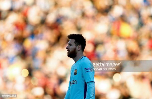 Barcelona's Argentinian forward Lionel Messi walks on the pitch during the Spanish league football match Leganes vs Barcelona at the Butarque stadium...