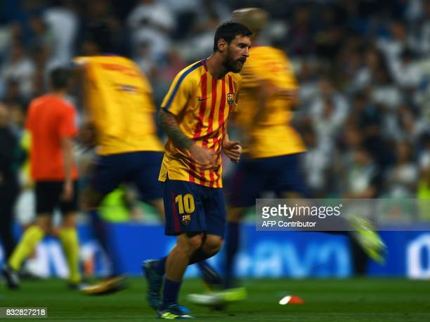 Barcelona's Argentinian forward Lionel Messi warms up before the second leg of the Spanish Supercup football match Real Madrid vs FC Barcelona at the...
