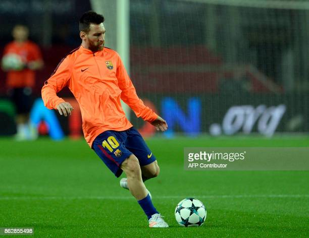 Barcelona's Argentinian forward Lionel Messi warms up before the UEFA Champions League group D football match FC Barcelona vs Olympiacos FC at the...