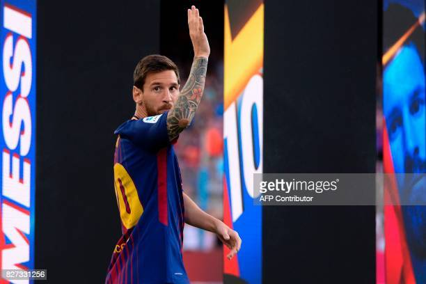 Barcelona's Argentinian forward Lionel Messi waves to supporters before the 52nd Joan Gamper Trophy friendly football match between Barcelona FC and...