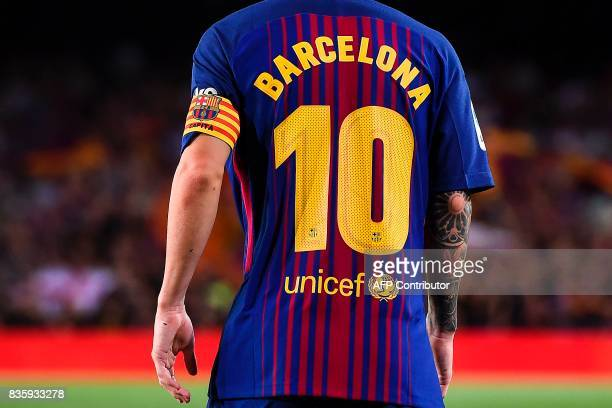Barcelona's Argentinian forward Lionel Messi wears a jersey reading 'Barcelona' instead of his name to pay tribute to the victims of the Barcelona...