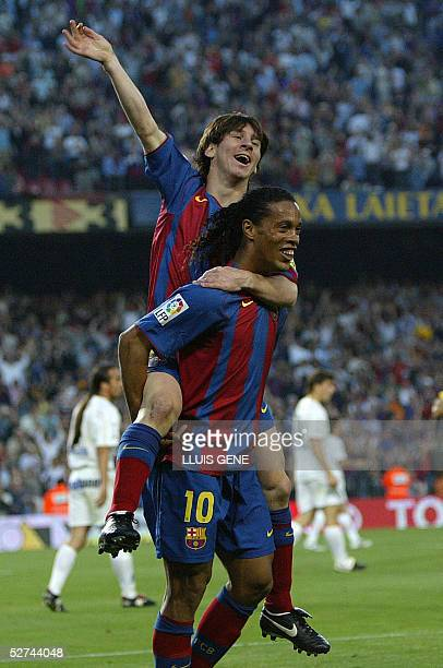 Barcelona's Argentinian Messi and Brazilian Ronaldinho celebrate their second goal against Albacete during their Spanish League football match at the...