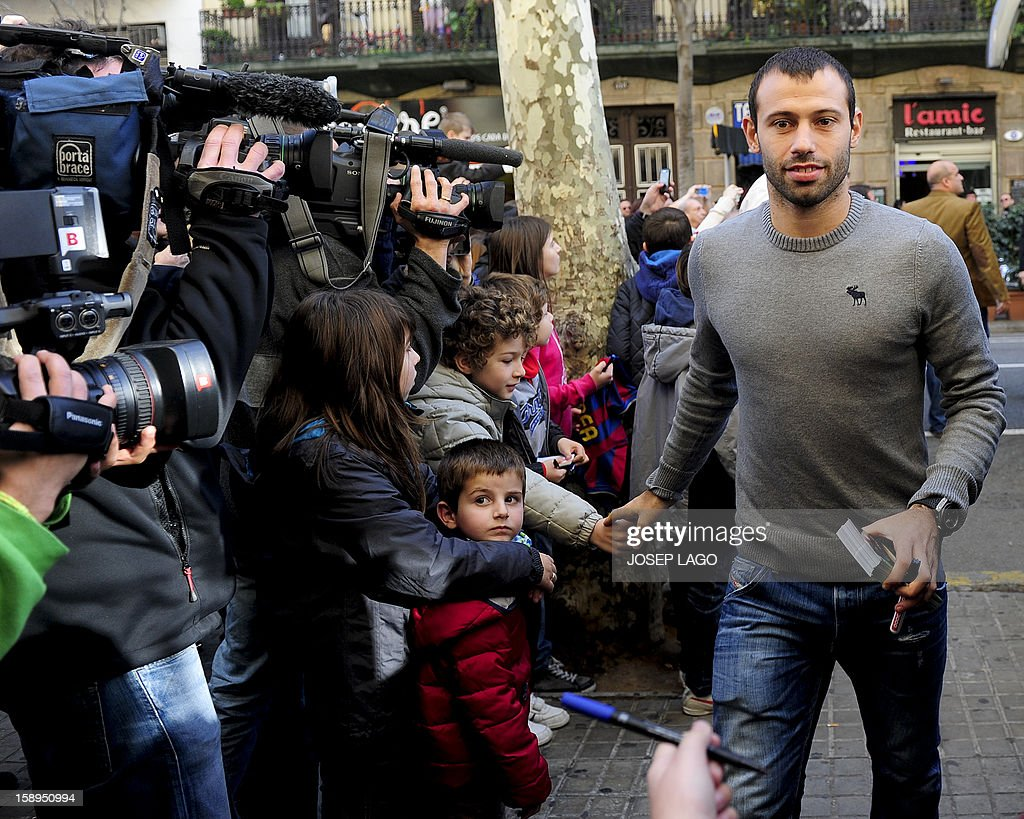 Barcelona's Argentinian midfielder Javier Mascherano for visit to children and medical staff at the Hospital de Nens (the Children's Hospital) in Barcelona on January 4, 2013.