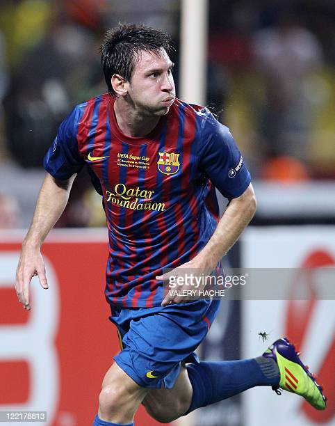 Barcelona's Argentinian midfielder Lionel Messi spits after scoring a goal during the UEFA Super Cup football match FC Barcelona vs FC Porto on...