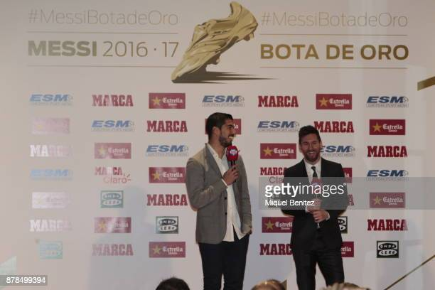 Barcelona's Argentinian striker Lionel Messi attends for his fourth Golden Boot trophy trophy from his Uruguayan teammate Luis Suarez as top scorer...