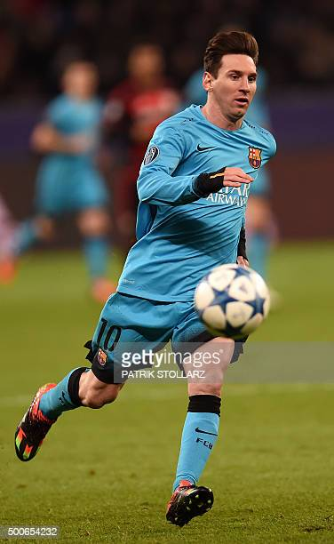Barcelona´s Argentinian striker Lionel Messi vies for the ball during the Group E secondleg UEFA Champions League football match Bayer 04 Leverkusen...