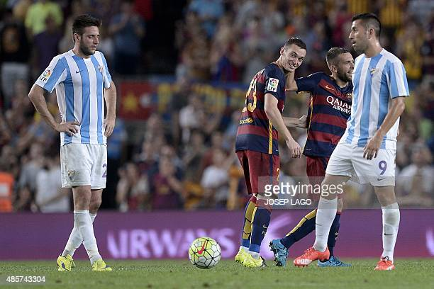 Barcelona's Belgian defender Thomas Vermaelen is congratulated by his teammate Barcelona's defender Jordi Alba after scoring during the Spanish...