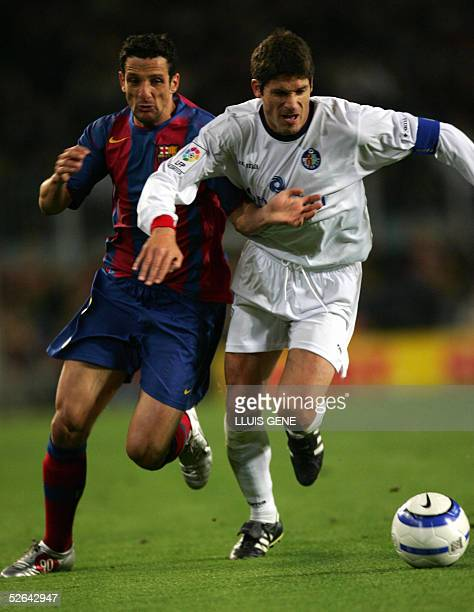 Barcelona's Brazilian Belletti vies for the ball with Getafe's Vivar Dorado during their Spanish League football match at the Camp Nou stadium in...