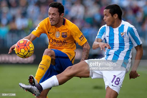 Barcelona's Brazilian defender Adriano vies with Malaga's Venezuelan defender Roberto Jose Rosales during the Spanish league football match Malaga CF...