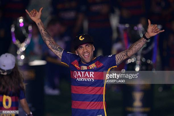 Barcelona's Brazilian defender Dani Alves acknowledges the crowd during celebrations at the Camp Nou stadium in Barcelona on May 23 2016 following...