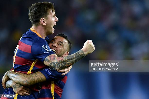 Barcelona's Brazilian defender Dani Alves and Barcelona's Argentinian forward Lionel Messi celebrate after scoring a goal during the UEFA Super Cup...
