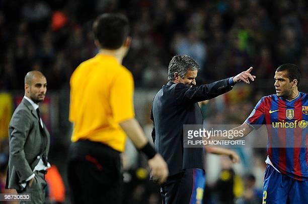 Barcelona's Brazilian defender Dani Alves and coach Josep Guardiola look at Inter Milan's Portuguese coach Jose Mourinho during the UEFA Champions...