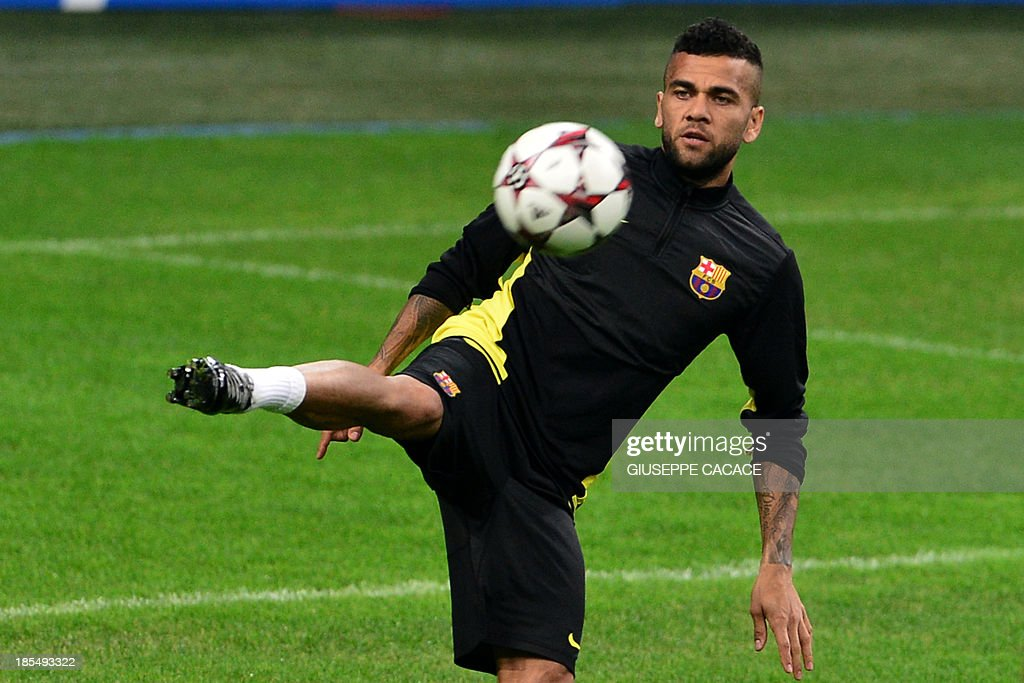 Barcelona's Brazilian defender Dani Alves attends a training session, on the eve of Champions League football match between AC Milan and FC Barcelona, on October 21, 2013 at the San Siro Stadium in Milan.