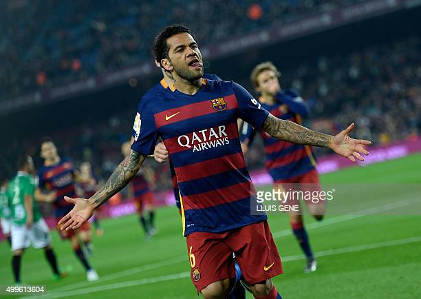 Barcelona's Brazilian defender Dani Alves celebrates after scoring a goal during the Spanish Copa del Rey Round of 32 second leg football match FC...