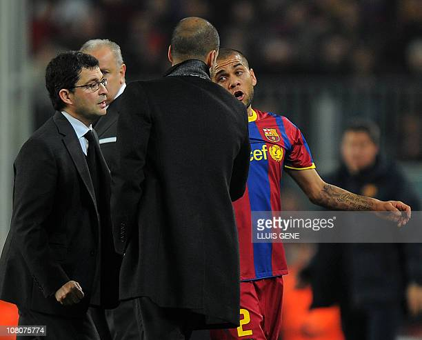 Barcelona's Brazilian defender Dani Alves chats with Barcelona's coach Josep Guardiola after he left the pitch for injuries during the Spanish league...