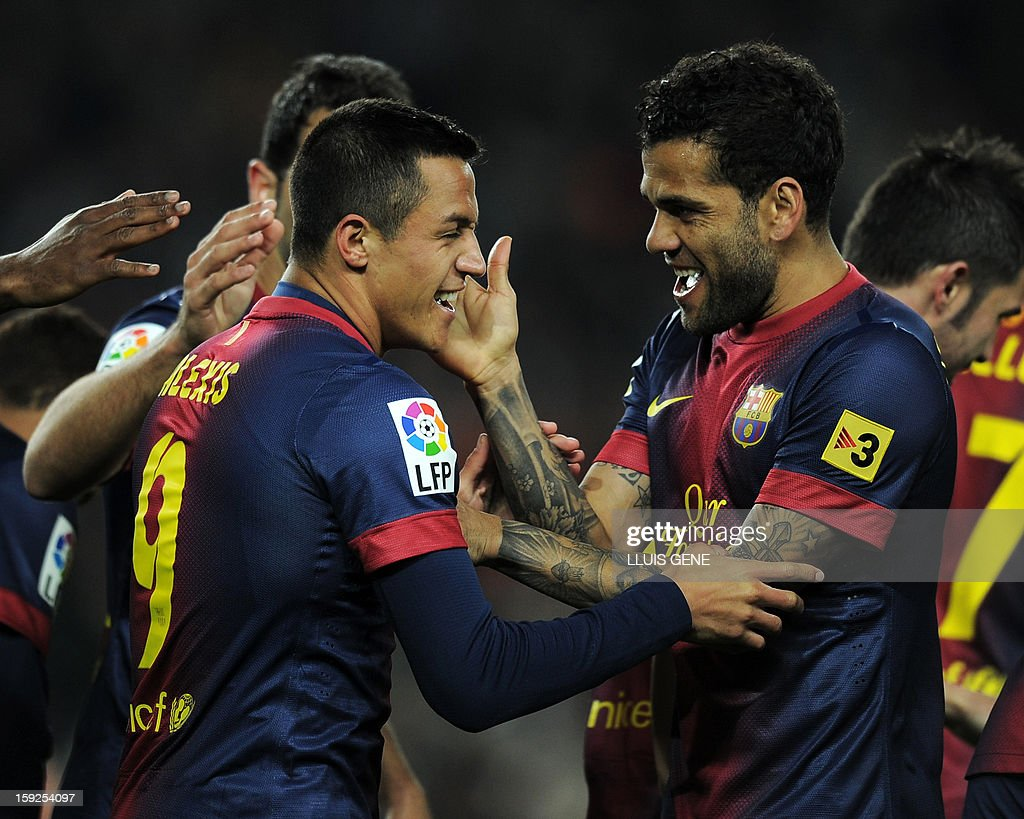 Barcelona's Brazilian defender Dani Alves (R) congratulates Barcelona's Chiliean forward Alexis Sanchez (L) on scoring during the Spanish Copa del Rey (King's Cup) football match FC Barcelona vs Cordoba CF at the Camp Nou stadium in Barcelona on January 10, 2013.