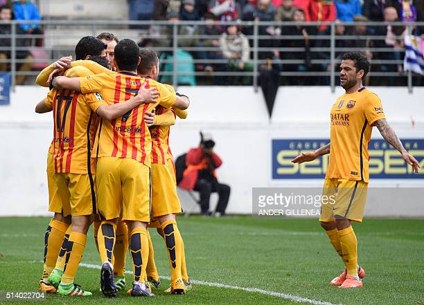 Barcelona's Brazilian defender Dani Alves joins his teammates as they celebrate after scoring during the Spanish league football match SD Eibar vs FC...