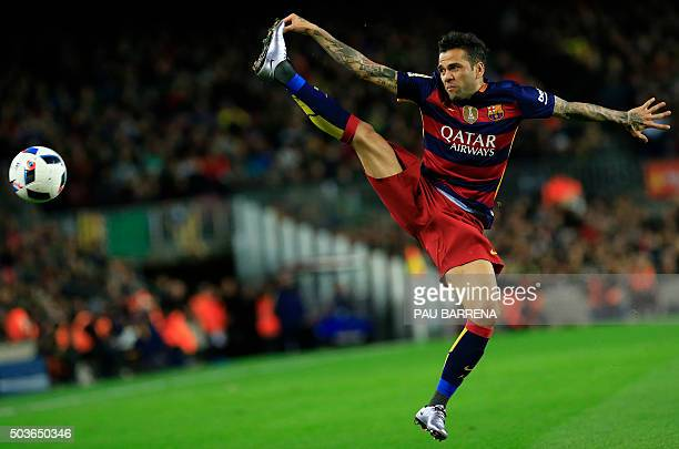 TOPSHOT Barcelona's Brazilian defender Dani Alves jumps for the ball during the Spanish Copa del Rey round of 16 first leg football match FC...