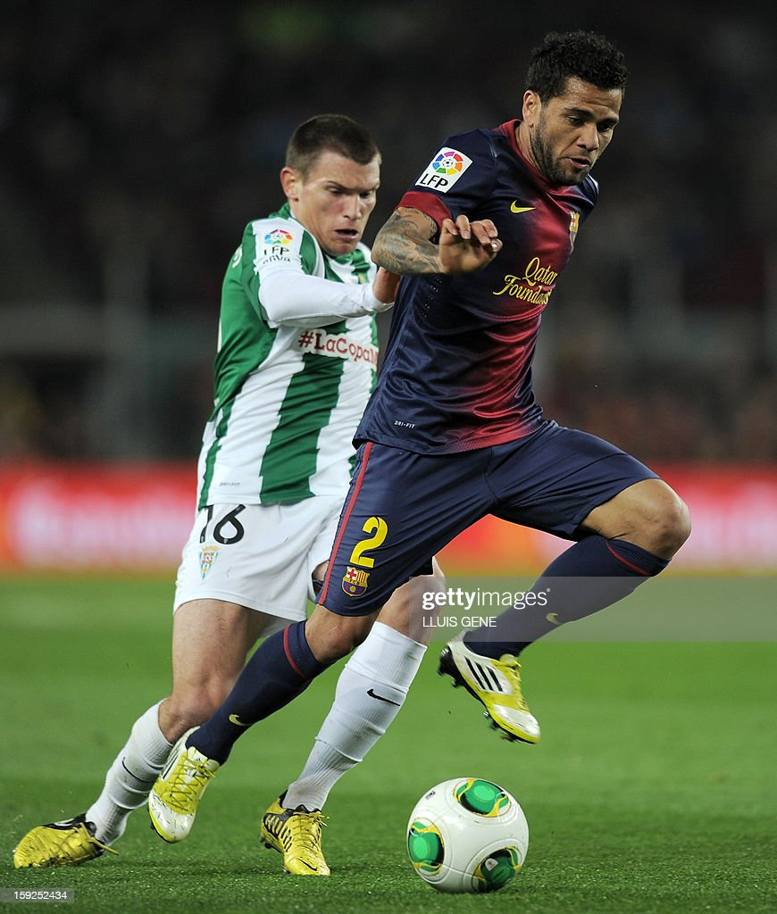 Barcelona's Brazilian defender Dani Alves vies with Cordoba's Argentinian forward Sebastian Dubarbier during the Spanish Copa del Rey (King's Cup) football match FC Barcelona vs Cordoba CF at the Camp Nou stadium in Barcelona on January 10, 2013.